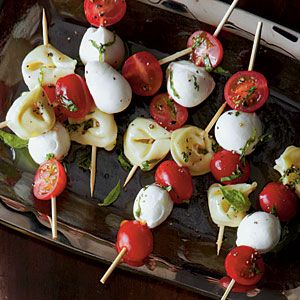 Tortellini Caprese Bites    These appetizer skewers drizzled with a basil vinaigrette are so simple to prepare and their no-mess presentation makes them ideal for parties