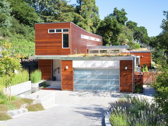 Blu homes sidebreeze in orinda green roof aluminum garage door with frosted glass panels
