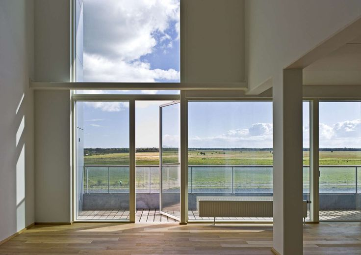8 HOUSE is located in Southern Ørestad on the edge of the Copenhagen Canal and with a view of the open spaces of Kalvebod Fælled. It is a big house in the li...
