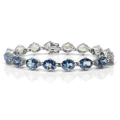 """Armbånd i 925 Sterling sølv dekorert med 16 stk blå topas. Total lengde: Ca 16,5 cm (6,5""""). Total vekt: 14,0 g. #smykke #armbånd #topas #925sterling #sølvsmykke #sølvarmbånd #zendesign"""