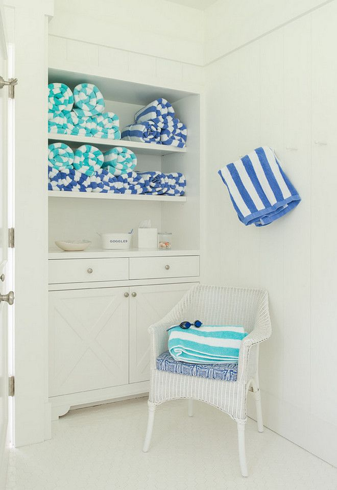 Pool house built-in cabinet to store towels for guests.  Brooks and Falotico Associates, Inc.