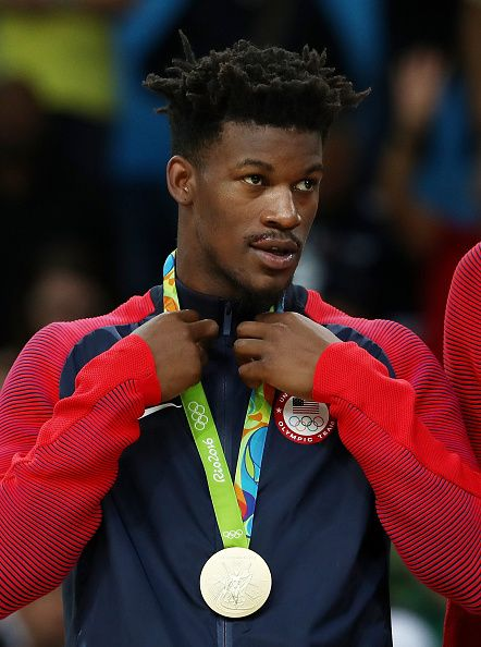 Gold medalist Jimmy Butler of the United States stands on the podium after…