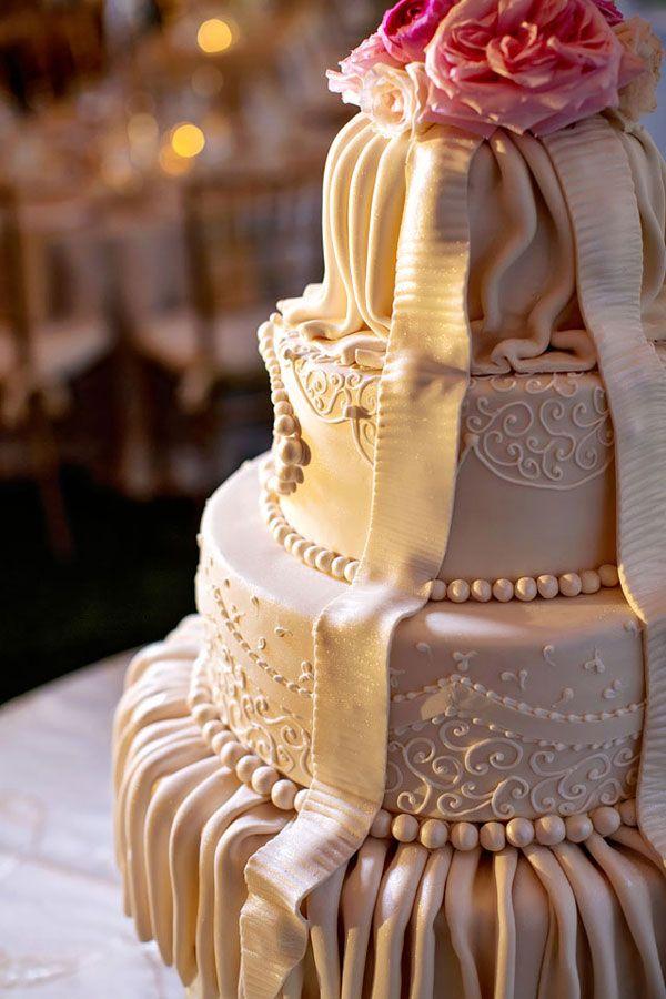 romantic draping on this stunning wedding cake!