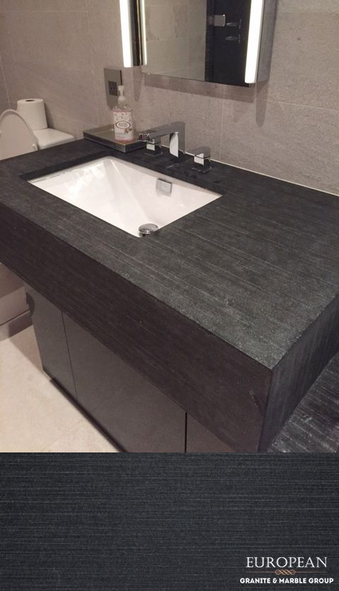 Gallery For Website This bathroom countertop features our Natura collection Black Absolute Striato design This Black Absolute Granite has been given a texture using a pattern