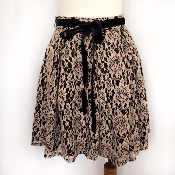 """Robbi & Nikki Lace Skirt✨Host Pick✨ Romantic floral taupe/beige and black lace skirt from Robert Rodriguez's Robbi & Nikki line. The outer layer features embroidered flowers on lace with a black underskirt. The embroidered flowers have a slightly fuzzy effect. Black velvet tie at the waist and invisible back zipper. Soft pleating all around skirt. 59% cotton; 41% nylon with polyester/cotton blend liner. Dry clean. Size 6. Waist: 14"""" flat across. Length: 19.5"""". Thanks for looking! Robbi…"""