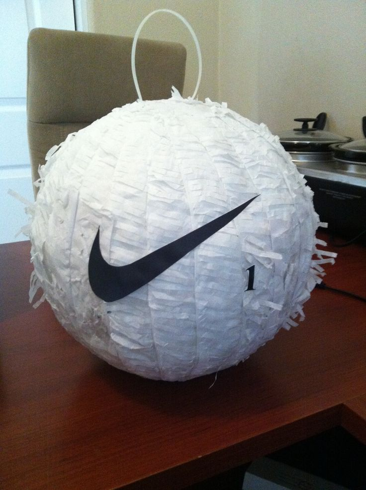 Golf Pinata.....I took a soccer pinata and took off the black spots...then I added a little tissue where it ripped then added the Nike Symbol.  It was super easy!!!