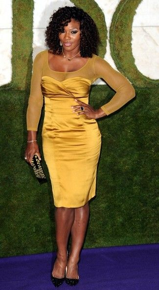 Tennis champion Serena Williams in a mustard yellow dress at the 2012 Wimbledon Champions Dinner