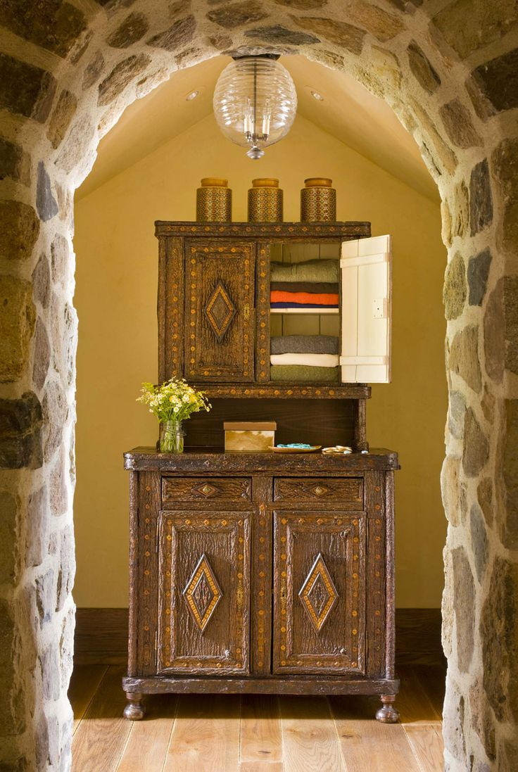 Rustic hutch turned linen closet - Colorado Mountain Ranch