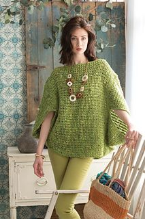 """Two rectangles, very different in proportion, create this swingy rhombus top. At 20""""/51cm tall by 40""""/101cm wide, the back piece folds forward at each end to shape the dolman sleeves, while at 20""""/51cm by 24""""/61cm, the front piece frames the silhouette's dimensions. Bright and fresh in Silk Garden Sock Solo #33 Pistachio, the allover pattern of crochet shell-stitch mesh offers plenty of drape. The boat neck creates an elegant backdrop for statement jewelry."""