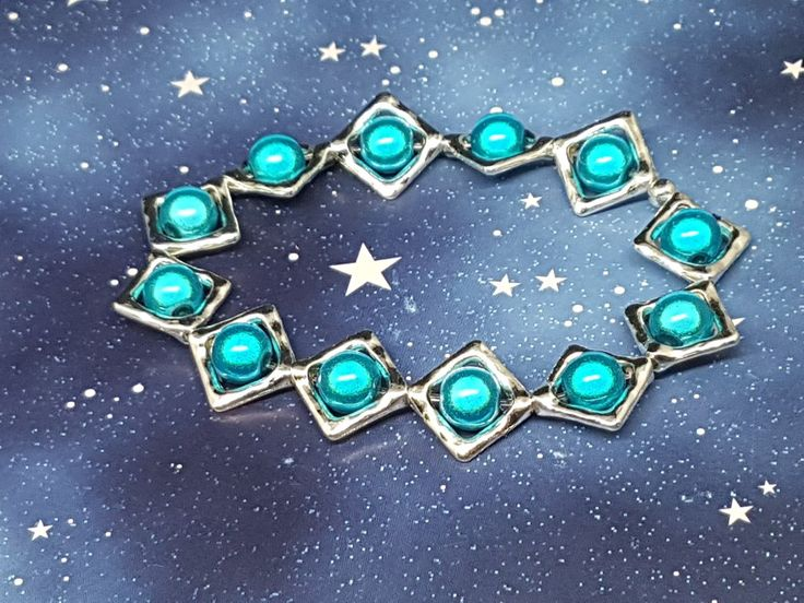 Beautiful blue miracle beads in frames.