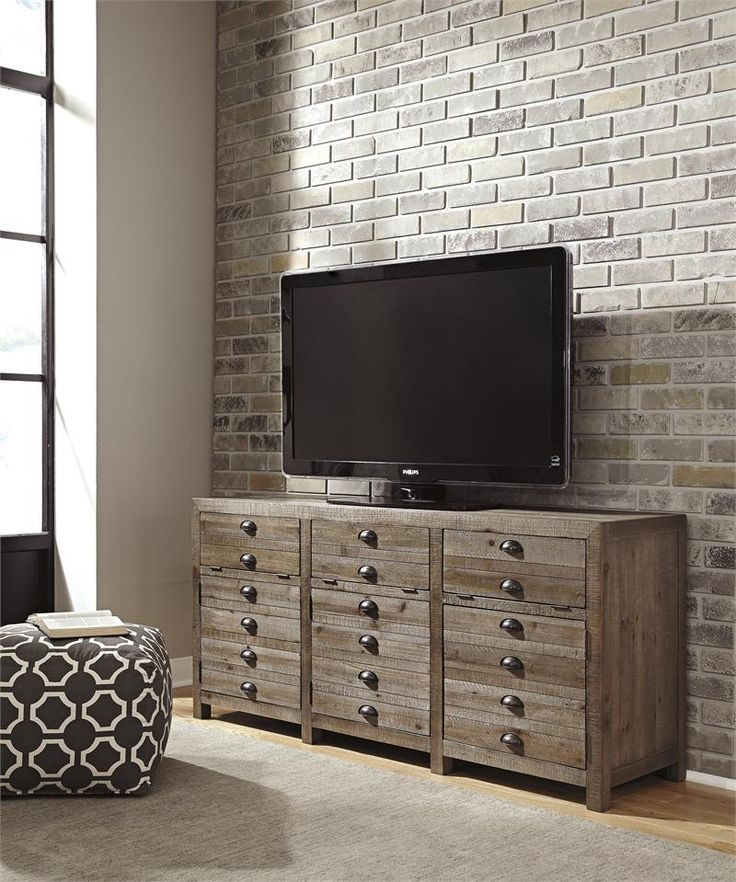 EXTRA LARRGE TV STAND Quality Bedding And Furniture in Orange Park offers a wide variety of entertainment centers at amazing low prices. #entertainmentcenter  #tvstand #ashleyfurniture  www.qualitybeddingfurniture.com