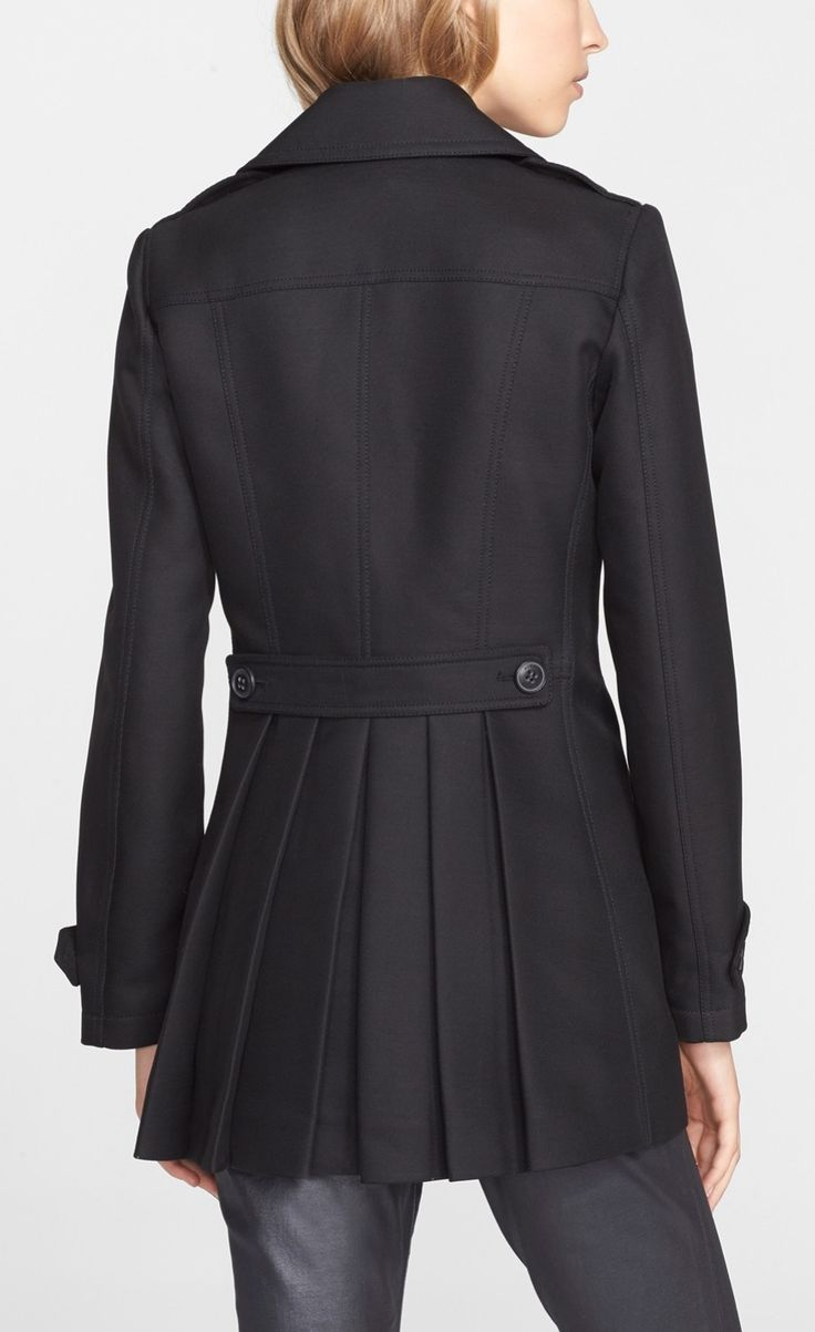 A double-breasted Burberry peacoat with crisp pleats to ...