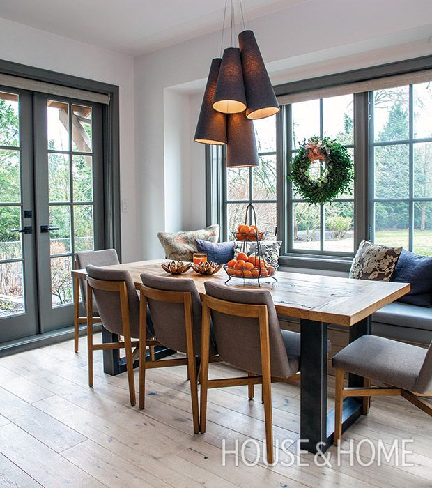 Cone-shaped pendant lights offer a modern moment in this breakfast area. | Photographer: Kim Christie |  Designer: Effie Genovese