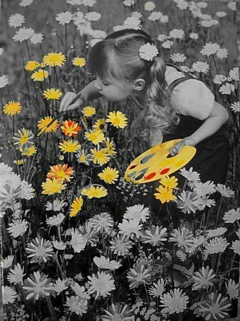 painting flowers...set up shot with a child holding a paintbrush and pallet in a field of flowers...convert to black and white photo...the rest is photo editing magic
