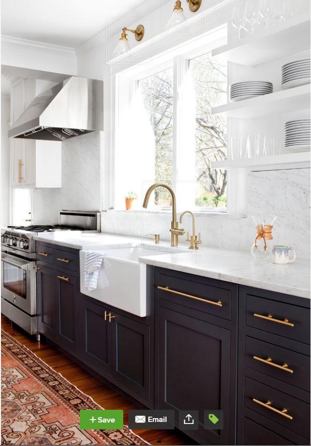 From Houzz - Wood floor, darker lower cabinets, white upper cabinets, brass hardware