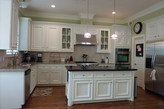 White Cabinets With Dark Granite On Island With Different