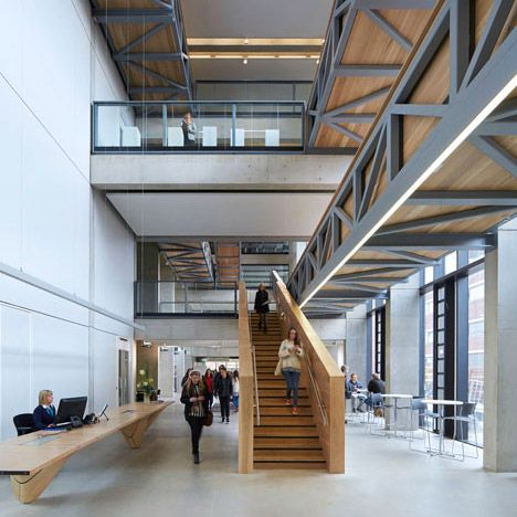 Art school extension with wooden stairs and bridges by Feilden Clegg Bradley Studios