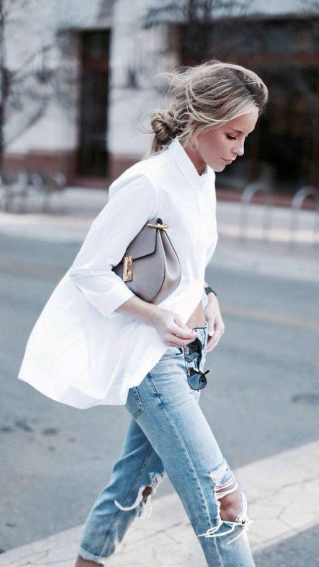 An oversized button-down shirt with ripped boyfriend jeans.
