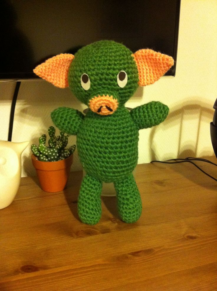 Crochet green pig. The famous Hungarian Mazsola pig.