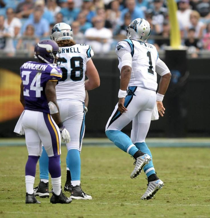Carolina Panthers quarterback Cam Newton (1) hops around after having his ankle twisted while being tackled by Minnesota Vikings defensive tackle Linval Joseph (98) in the first half at Bank of America Stadium on Sunday, September 25, 2016. The slight injury forced Newtown out of the game for one play. The Vikings won, 22-10.