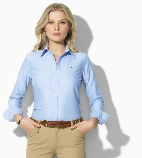 For a casual look, tuck your oxford shirt-- be it striped, white or light blue -- into a belted pair of khaki chinos or dark-stained jeans. Add a pair of oxford dress shoes or loafers to either pant for a sleeker look. Or, wear a knit sweater over your oxford and style it with a pair of tennis shoes.