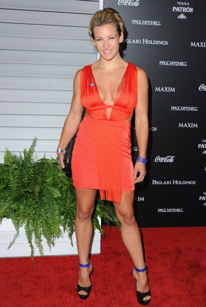 Miesha Tate looking freaking HOT in a low cut orange mini dress! ...  #MieshaTate