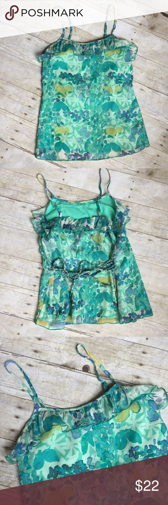 Jessica Simpson Floral Green Cami Tank Blouse NWT Jessica Simpson Floral Green Cami Tank Blouse - NEW with tags. Pretty green/blue/yellow Floral pattern. Ruffle at the top and braided rope tie at the waist. Size x-small. Top Floral layer is sheer with a solid green lining. 100% polyester. Jessica Simpson Tops