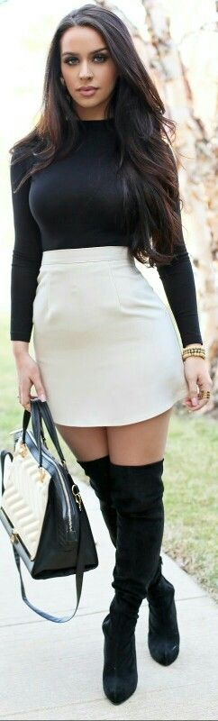 Amazing black wool sweater and white mini dress with black suede thigh high boots and handbag. The perfect fall look.