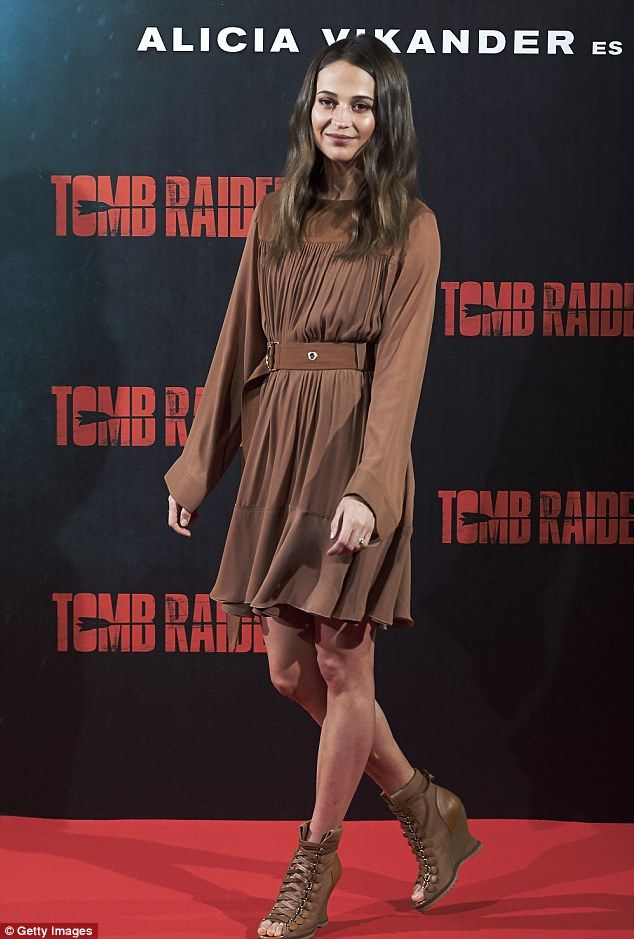 Retro style: Alicia Vikander turned heads as she promoted the Tomb Raider reboot at a phot...