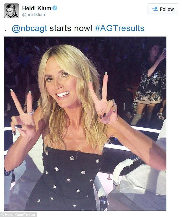 Double peace signs: Heidi - who could care less - currently judges the 10th season of Amer...