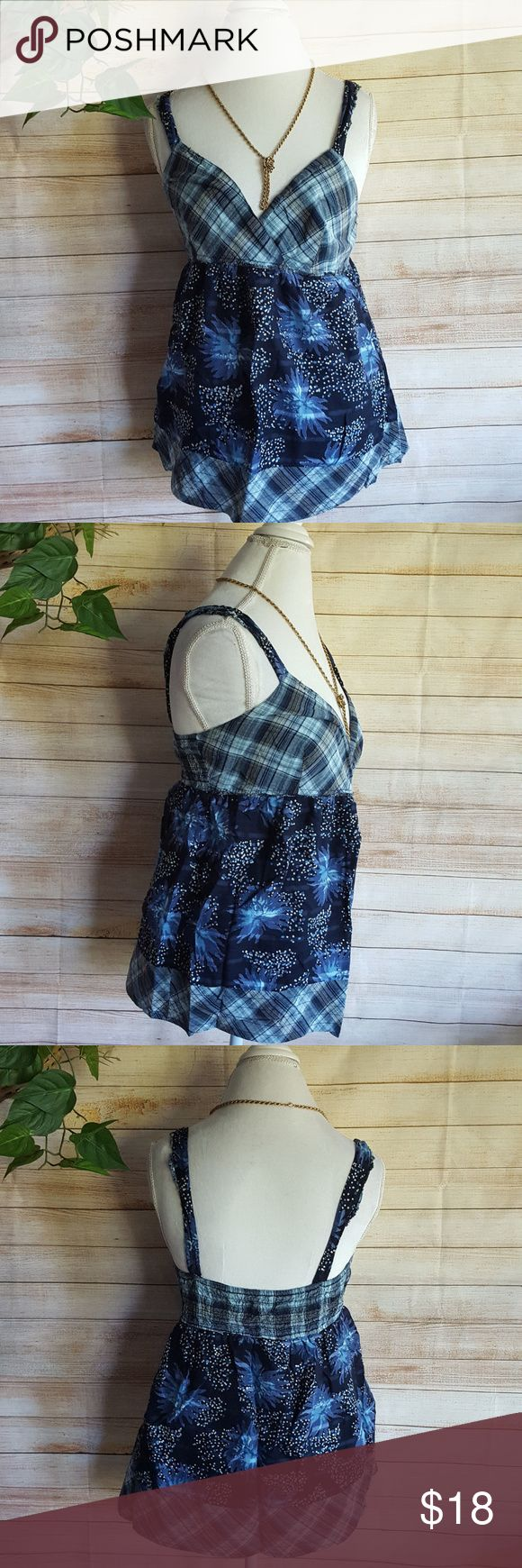 Calvin Klein Jeans Tank Top Cami Babydoll Blue L Calvin Klein Jeans Womens Tank Top Babydoll Cami Blue Sweetheart Neckline Sz L  Flawless pre-owned condition!  A lovely addition to your wardrobe.  Brand:  Calvin Klein Jeans  Size:  Large  Style:  Camisole, top with straps, V-neck, stretchy panel across the back  Pockets:  No  Fabric:  100% cotton  Care:  Machine wash cold  Features:  Lined.  Measurements (all taken with garment flat, unstretched)  Bust: 16.5  inches Calvin Klein Jeans Tops