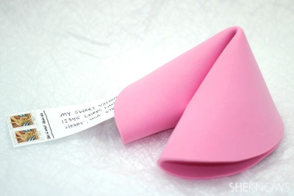 Mail a foam paper giant fortune cookie. Step-by-step photo tutorial by She Knows.