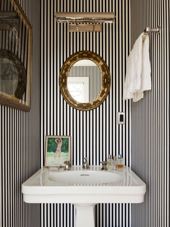 steven sclaroff.  black & white striped powder room.