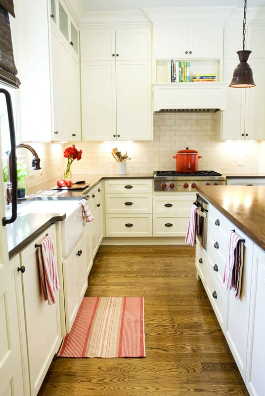 white kitchen cabinets with butcher block countertops butcher block countertops are back polished and 28989