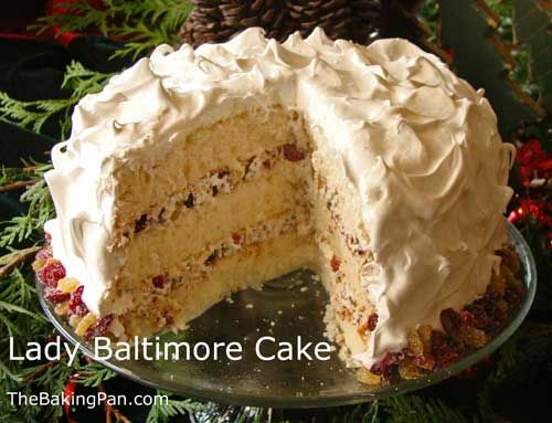 Lady Baltimore cake.  Sub the cranberries for cherries and the triple sec for kirschwasser