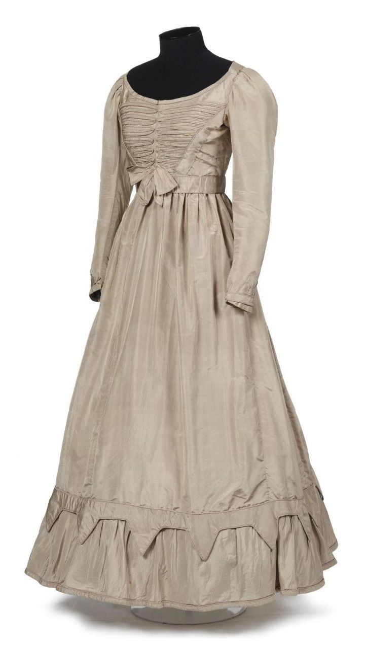 """Dress: ca. 1840, English, silk taffeta. """"This dress was intended to be part of Mary Burnett's 'going away' outfit - an outfit worn by a bride as she leaves her wedding with her new husband. However, when Mary immigrated to New Zealand with her family in 1852 she was still single, having left behind a broken engagement to a clergyman in Northumberland, North East England."""""""
