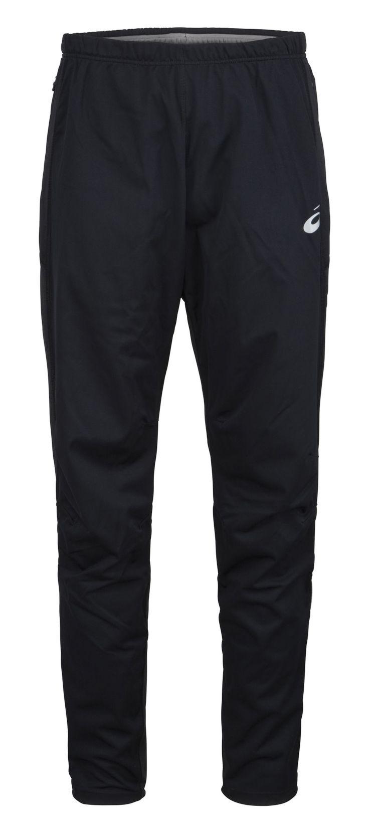 Miesten tuulisuojattut housut. Lahkeissa vetoketjut ja vyötärössä vetoketjulliset taskut.
