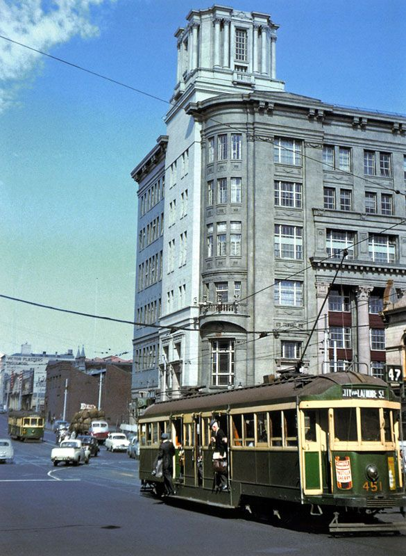 """The Argus building, corner La Trobe and Elizabeth Streets, 1950s. Still there today, but unoccupied and in danger of """"demolition by neglect"""". From Trams and Streetscapes, Metropolitan Melbourne 1950s-1960s"""
