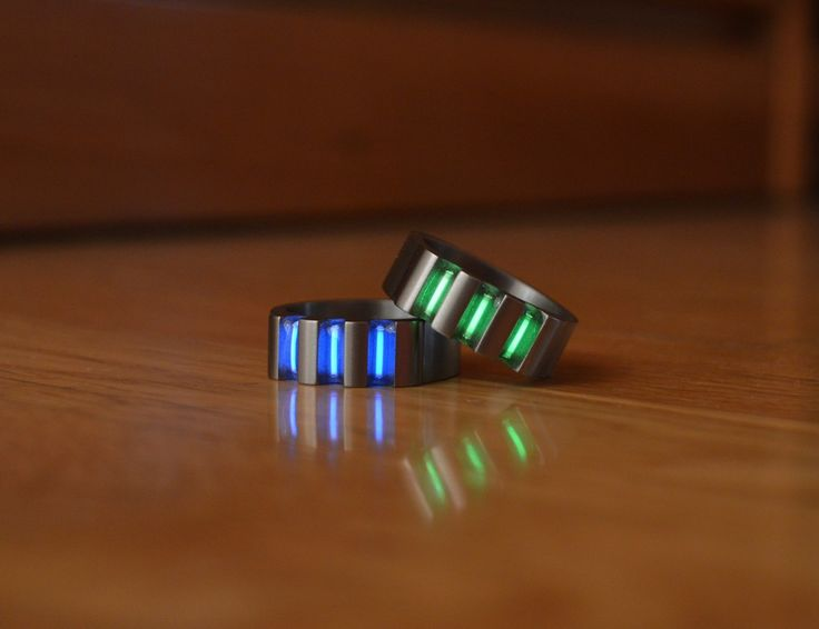 Unique rings made out of Titanium with three embedded Tritium vials. Tritium (symbol T or 3H, also known as hydrogen-3) is a radioactive isotope of hydrogen and one of the most valuable substances on earth, with a market price of 30.000$ per gram.