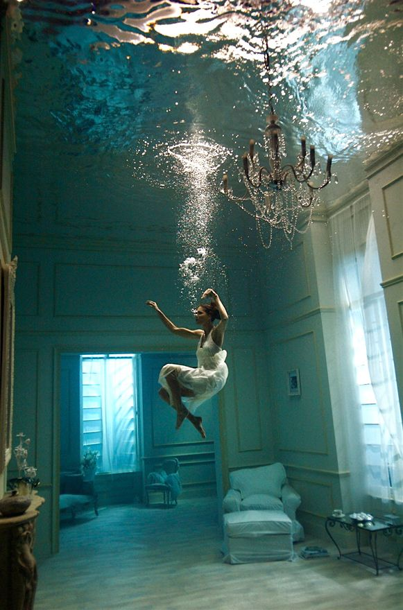Photographer Phoebe Rudomino | brilliant underwater fashion editorial | chandelier | bubbles | graceful | floating | breathe | aquatic | blues and green | wow | amazing photography | lounge room | underwater set |