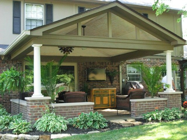 Pictures of a patio roof addition over an existing backyard patio in Carmel, Indiana. Features include round fiberglass columns, vaulted ceiling and skylights. What makes this project unique is that it was constructed over the existing brick knee-walls surrounding the patio area.