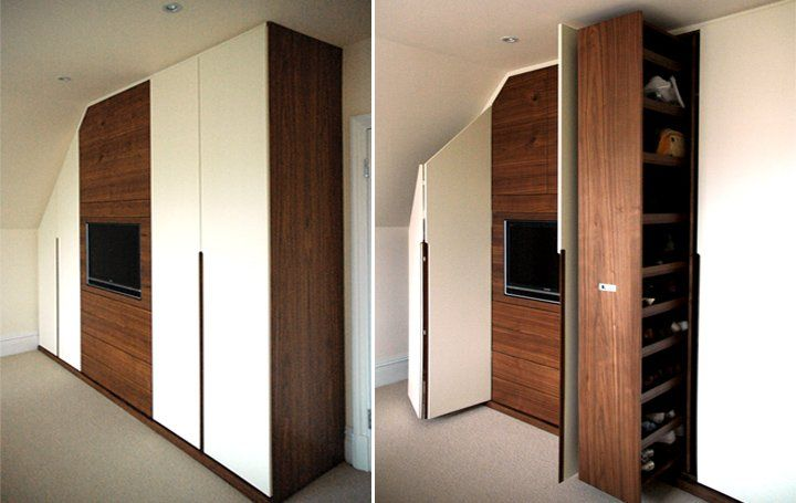 Attic wardrobes including pull-out shoe storage and media centre.