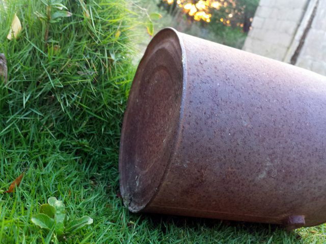 How to Make a Cheap Grass Seed Spreader The bottom of the can