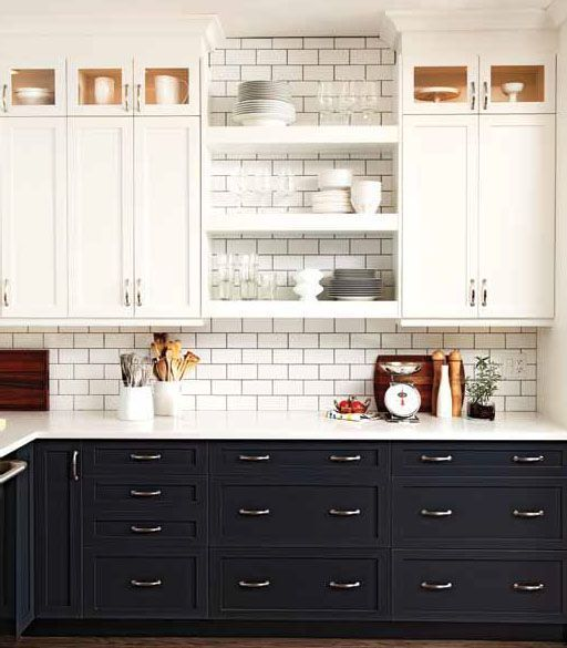 clean contrast Not a fan of the two different colors of cabinets but I like the subway tile and open cabinet