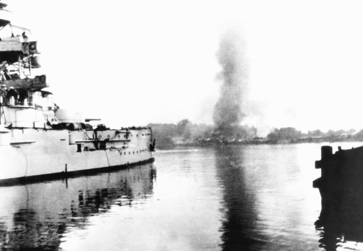 This photo shows the scene one week later, on September 1, 1939, one of the first military operations of Germany's invasion of Poland, and the beginning of World War II. Here, the German battleship Schleswig-Holstein is bombing a Polish military transit depot at Westerplatte in the Free City of Danzig. Simultaneously, the German Air Force (Luftwaffe), and ground troops (Heer) were attacking several other Polish targets. machine