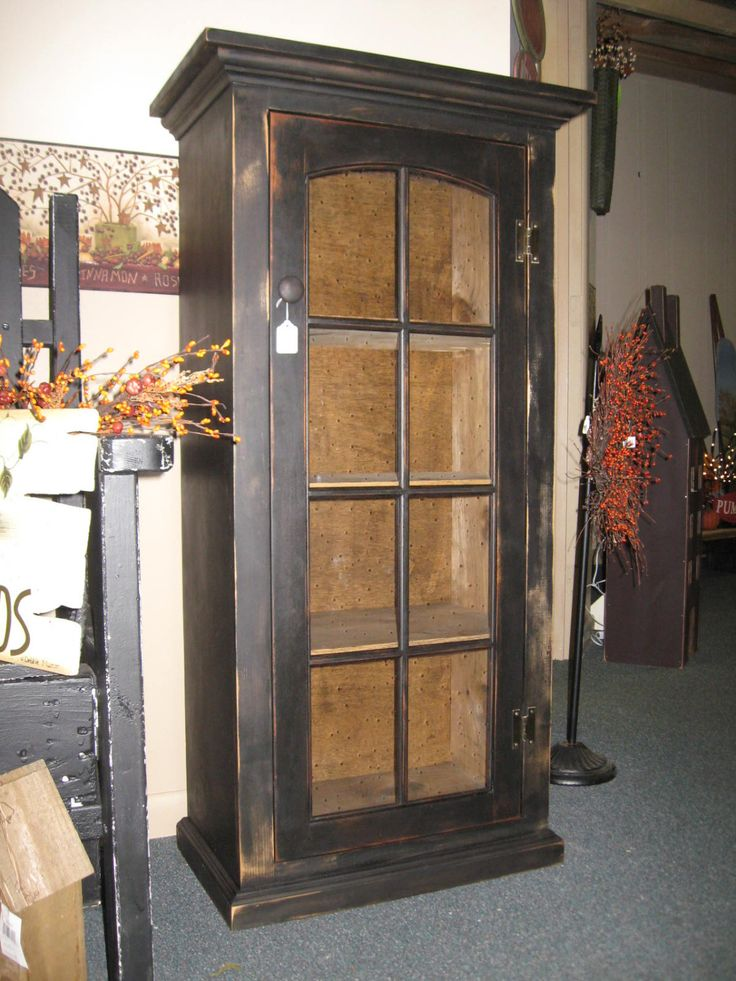 Primitive Cabinet with Glass door. $199.00, via Etsy.