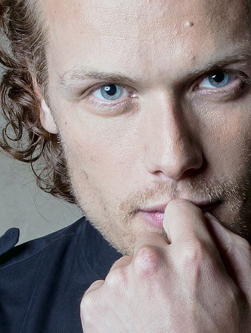 Absolutely love this picture of Sam Heughan, gorgeous eyes, and everything else isn't bad either.