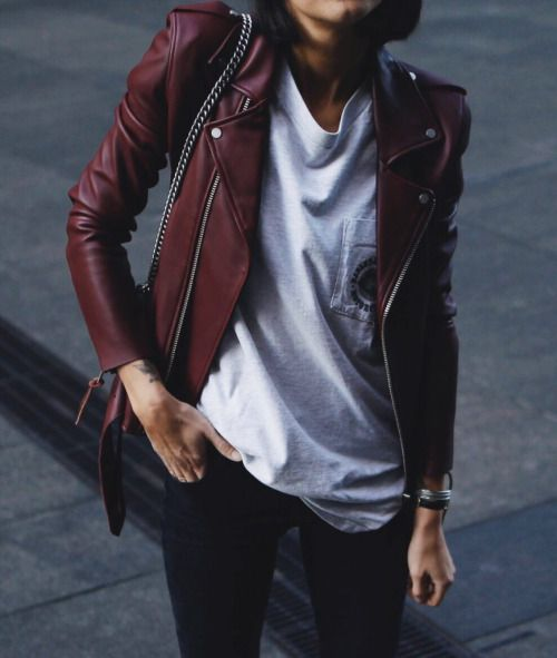 burgundy leather jacket, dark wash jeans, skull tshirt, black converse, necklace or earrings