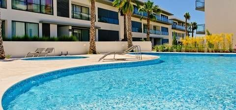 Cavalo Preto Condominium Algarve Quarteira Situated 3.6 km from Aquashow Water Park in Quarteira, this air-conditioned apartment features free WiFi and a balcony. Free private parking is available on site.