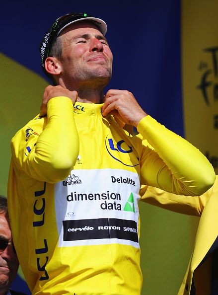 #TDF2016 Mark Cavendish of Great Britain and Team Dimension Data dons the yellow jersey on the podum after victory during Stage One of Le Tour de France 2016...